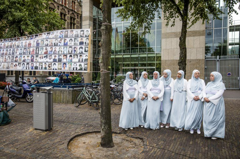 People attend a commemoration of the Srebrenica genocide at The Hague on 11 July (AFP)