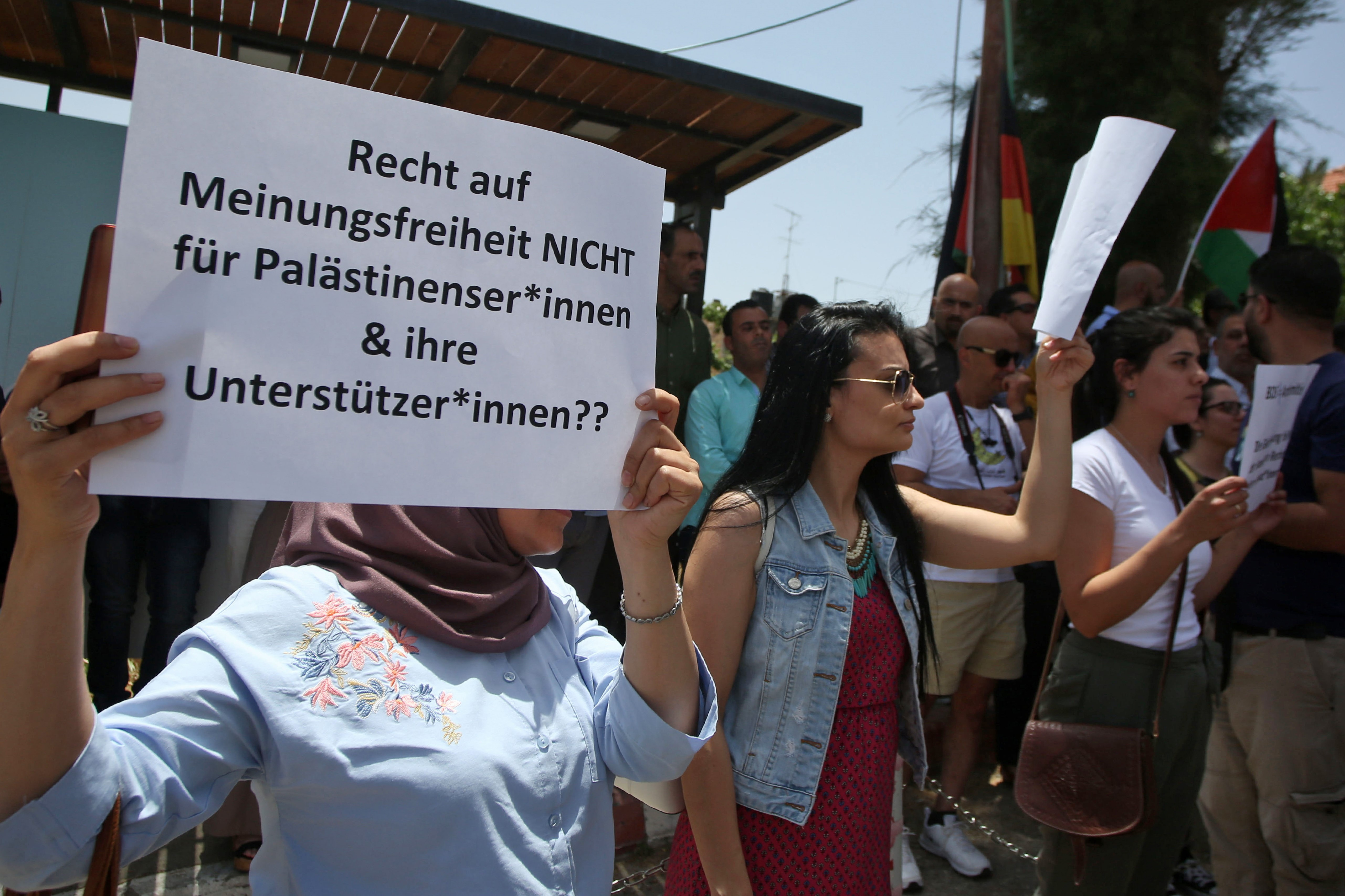 Protesters stage a demonstration outside Germany's Representative Office in Ramallah in the Palestinian West Bank on May 22, 2019, following the Bundestag's (German parliament) condemnation of the Boycott, Divestment, Sanctions (BDS) movement as anti-Semitic.