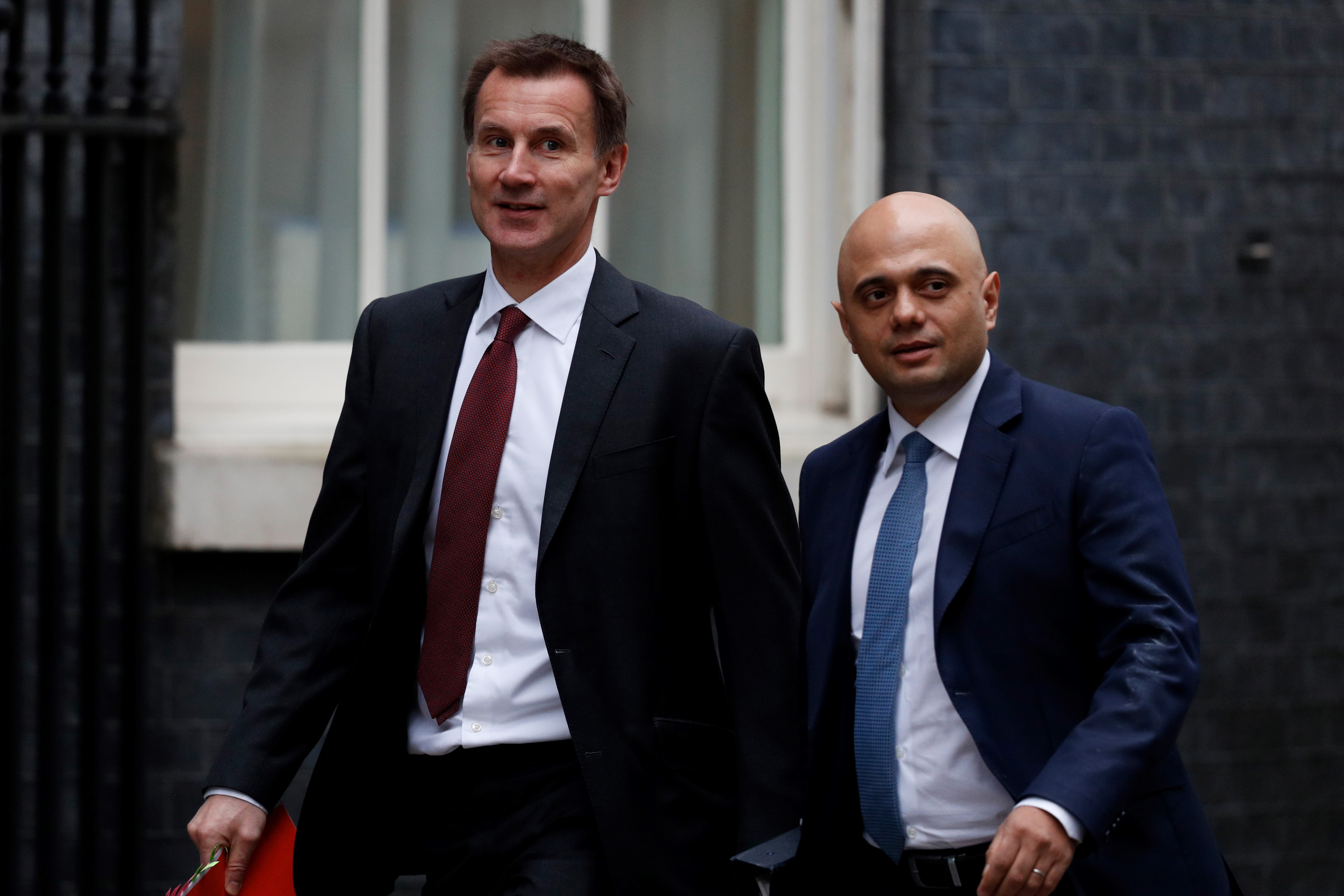 Britain's Foreign Secretary Jeremy Hunt (L) and Britain's Home Secretary Sajid Javid arrive for the weekly cabinet meeting at 10 Downing street in London on 15 January, 2019 (AFP)