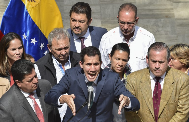 Venezuela's self-proclaimed acting president, Juan Guaido, speaks to the media in Caracas on 4 February (AFP)