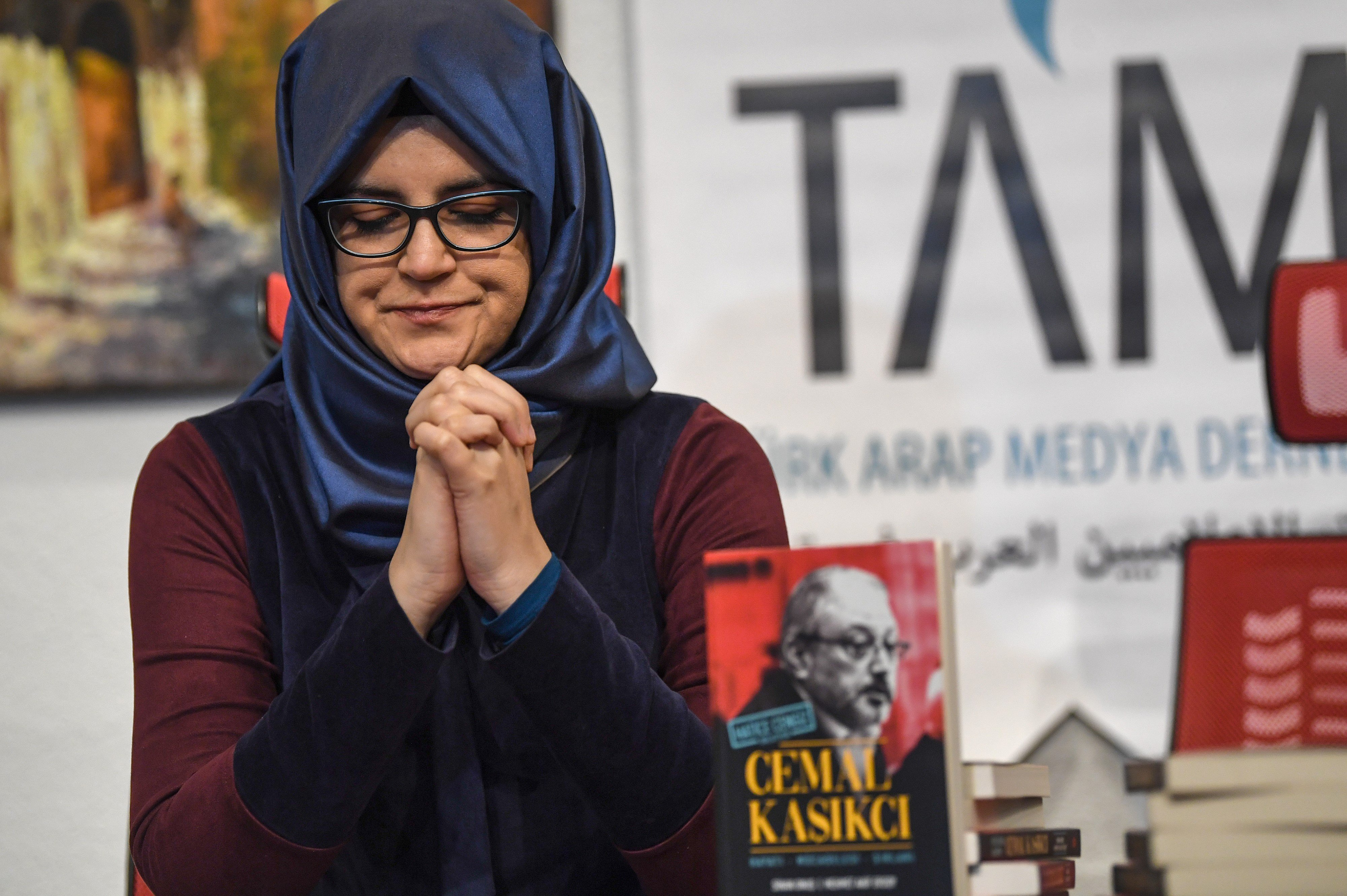 "Hatice Cengiz, fiancee of Jamal Khashoggi sits next to her book on February 8, 2019 during a presentation press conference of a book named ""Jamal Khashoggi"" in Istanbul (AFP)"