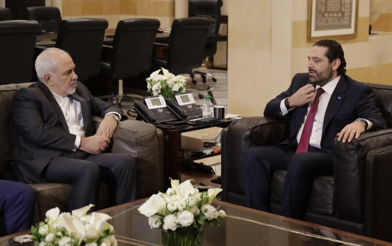 Iranian Foreign Minister Mohammad Javad Zarif meets Lebanese Prime Minister Saad Hariri in Beirut on 11 February (AFP)
