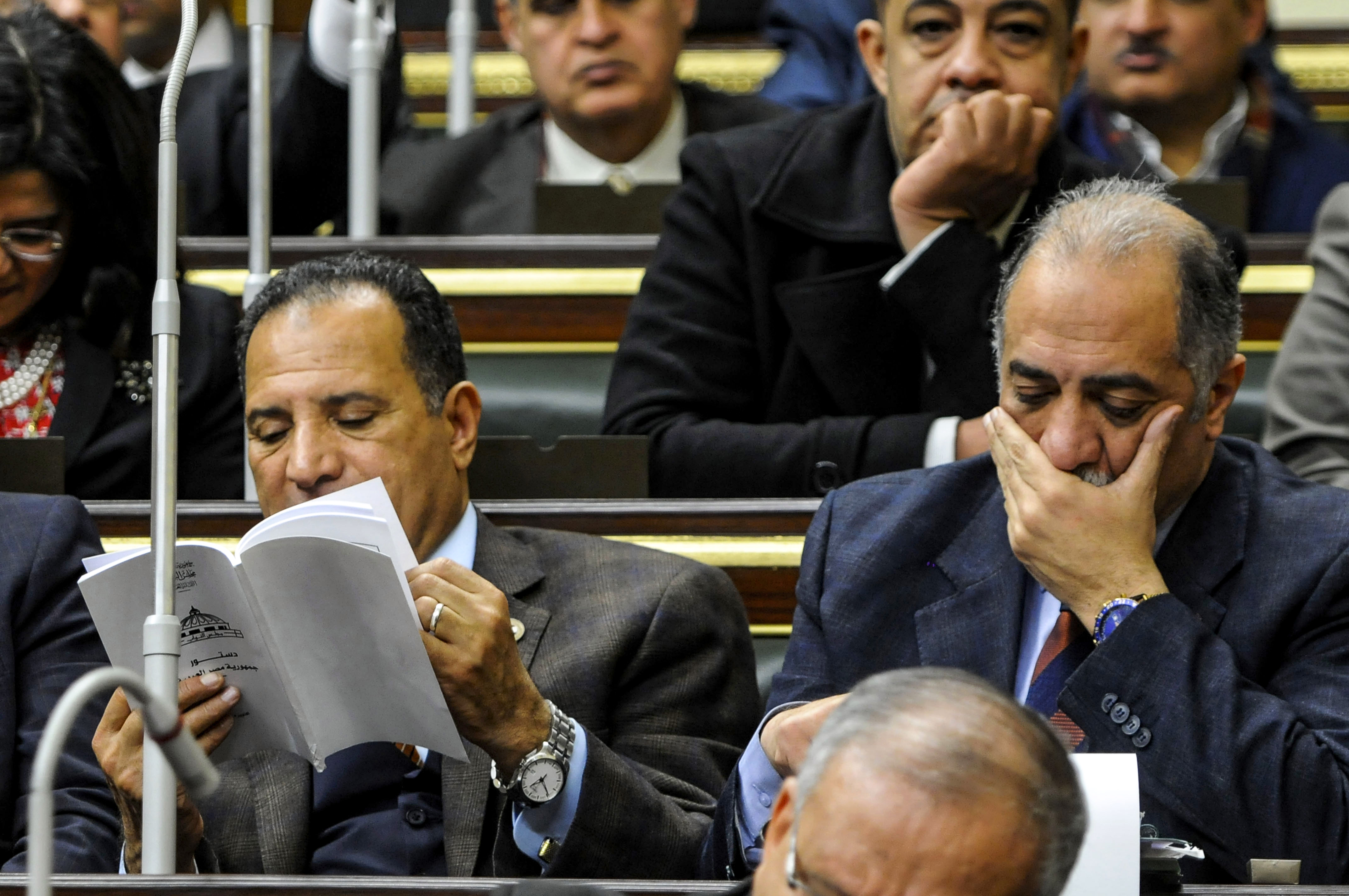 Members of Egypt's parliament attend a plenary session to deliberate the proposed constitutional amendments (AFP)