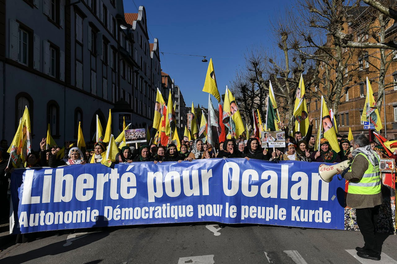 "People march with a banner reading ""Freedom for Ocalan"" during a rally in support of the jailed Kurdish leader Abdullah Ocalan (AFP)"