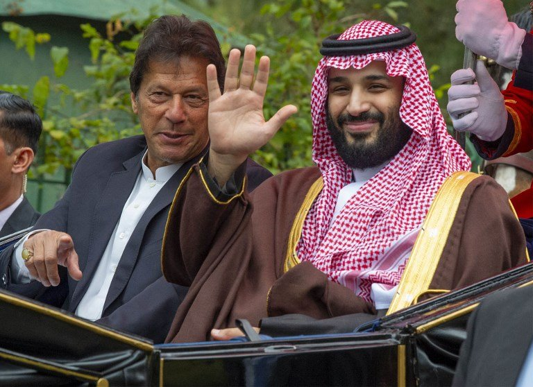 Khan and MBS ride in a carriage in Islamabad on 18 February (Bandar al-Jaloud/Saudi Royal Palace/AFP)