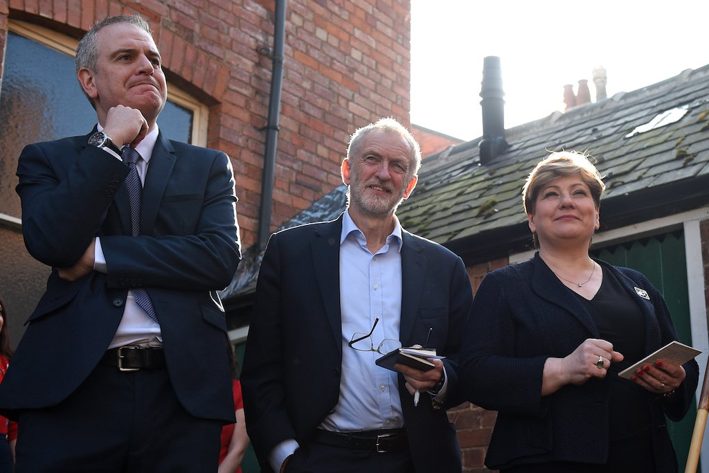 Opposition Labour party leader Jeremy Corbyn (C) waits with shadow foreign secretary Emily Thornberry (R) and Prospective Parliamentary Candidate for Broxtowe, Greg Marshall (L) ahead of Corbyn's address at a rally on February 23, 2019, in Broxtowe, central England (AFP)