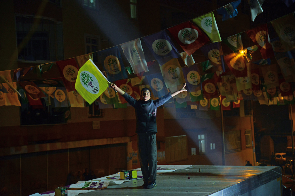 A young supporter of the pro-Kurdish Peoples' Democratic Party (HDP) celebrates after the local elections, in Diyarbakir (AFP)