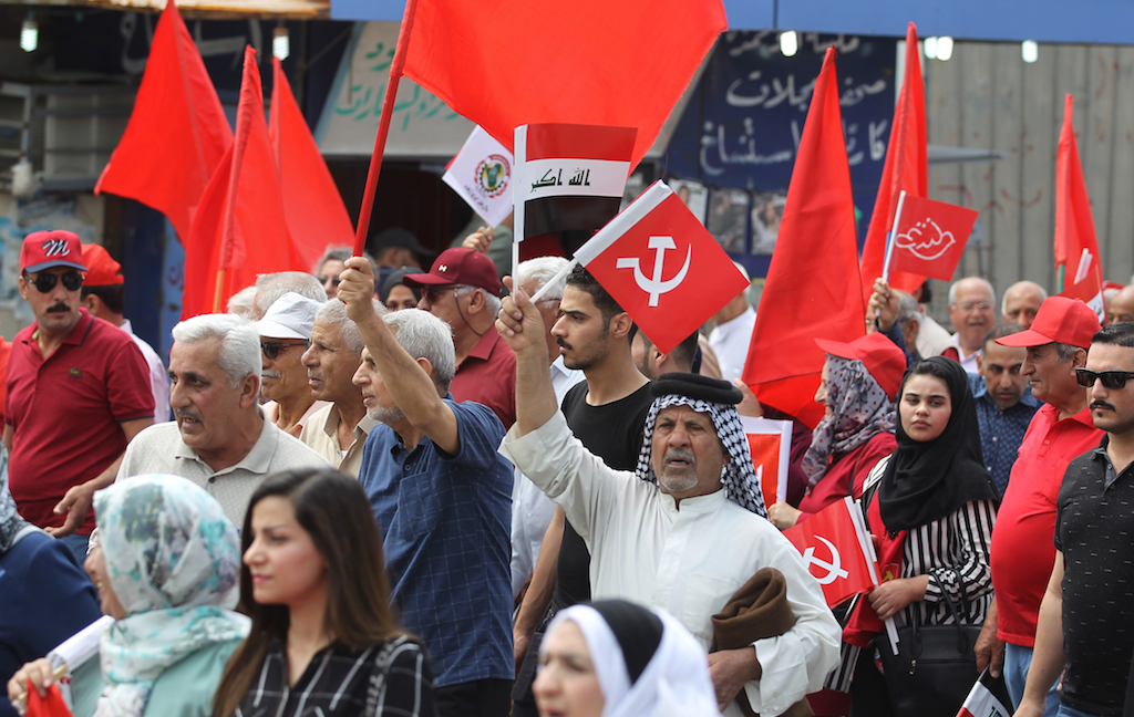 Supporters of the Iraqi Communist Party take part in a rally marking Labour Day in the capital Baghdad