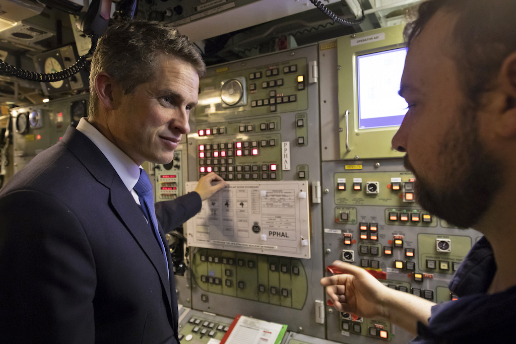 Former Defence Secretary Gavin Williamson (L) speaks with staff during a visit to Vanguard-class submarine HMS Vigilant at HM Naval Base Clyde (AFP)