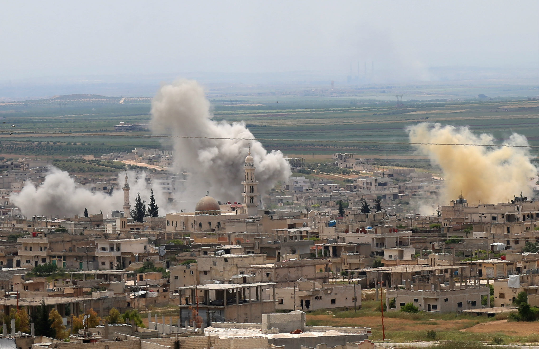 Smoke billows following reported Syrian government forces' bombardment in the town of Khan Sheikhoun (AFP)