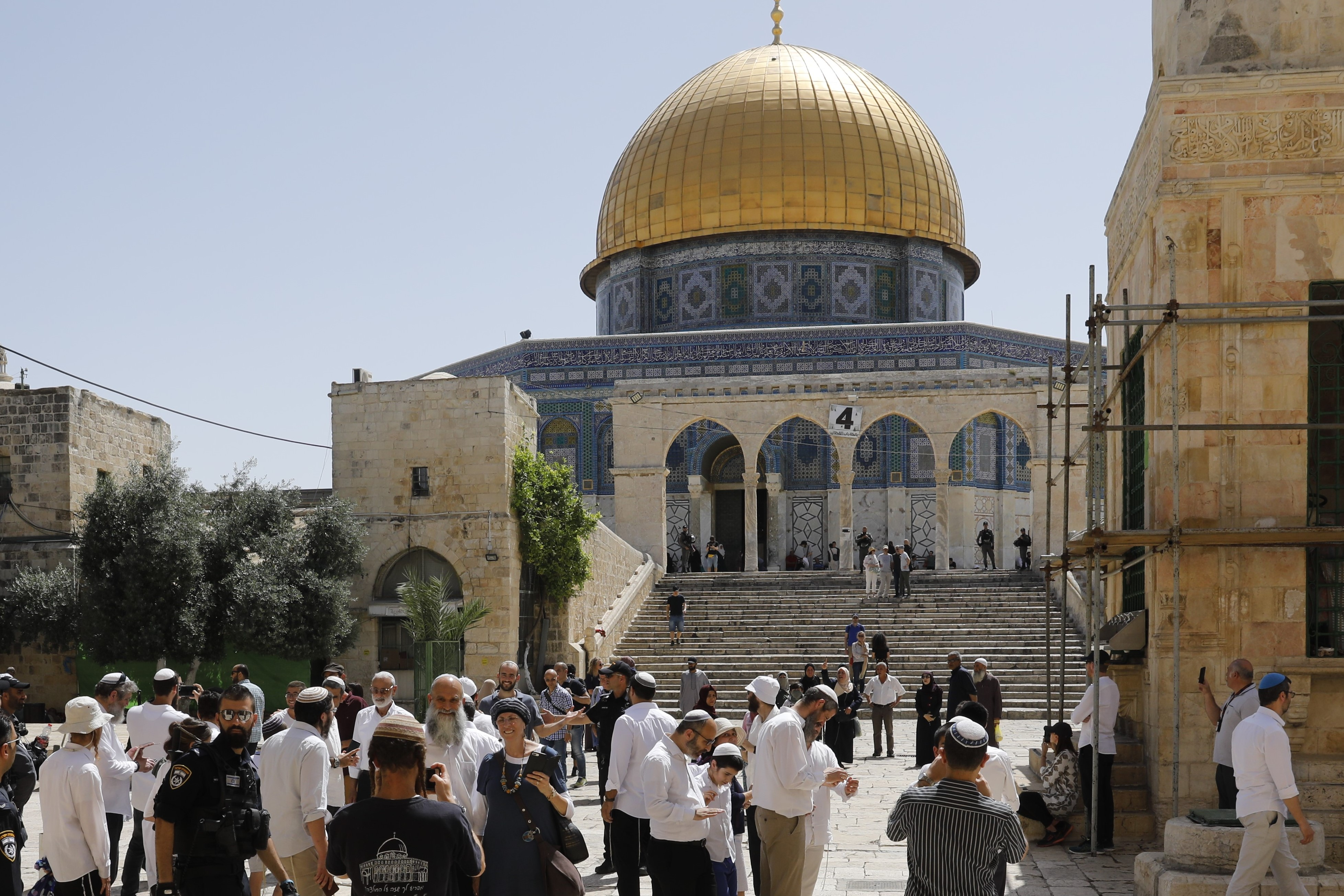 Israeli security forces escort a group of Jewish settlers visiting the Al-Aqsa Mosque compound on 2 June (AFP)