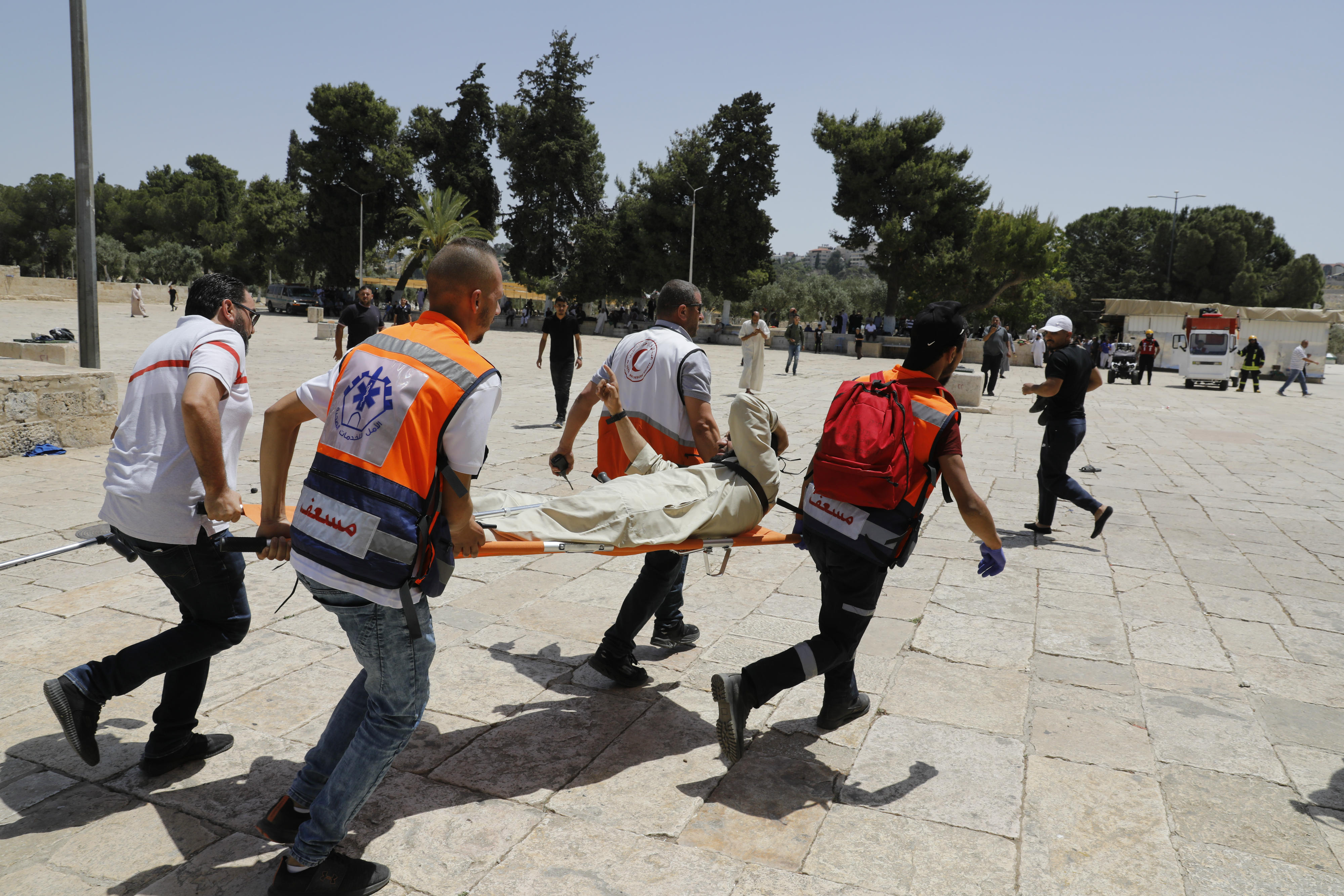 Palestinian medics evacuate a man at the al-Aqsa Mosque compound, in the Old City of Jerusalem (AFP)