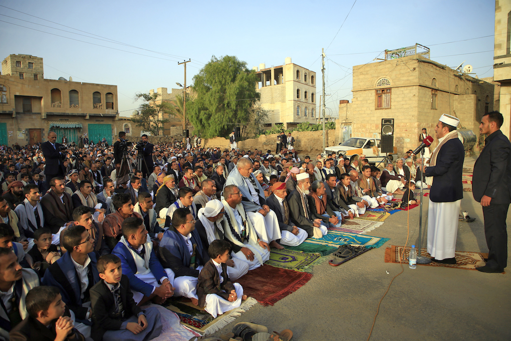 Yemeni Muslim worshippers perform Eid al-Fitr prayers at a square in the capital Sanaa (AFP)