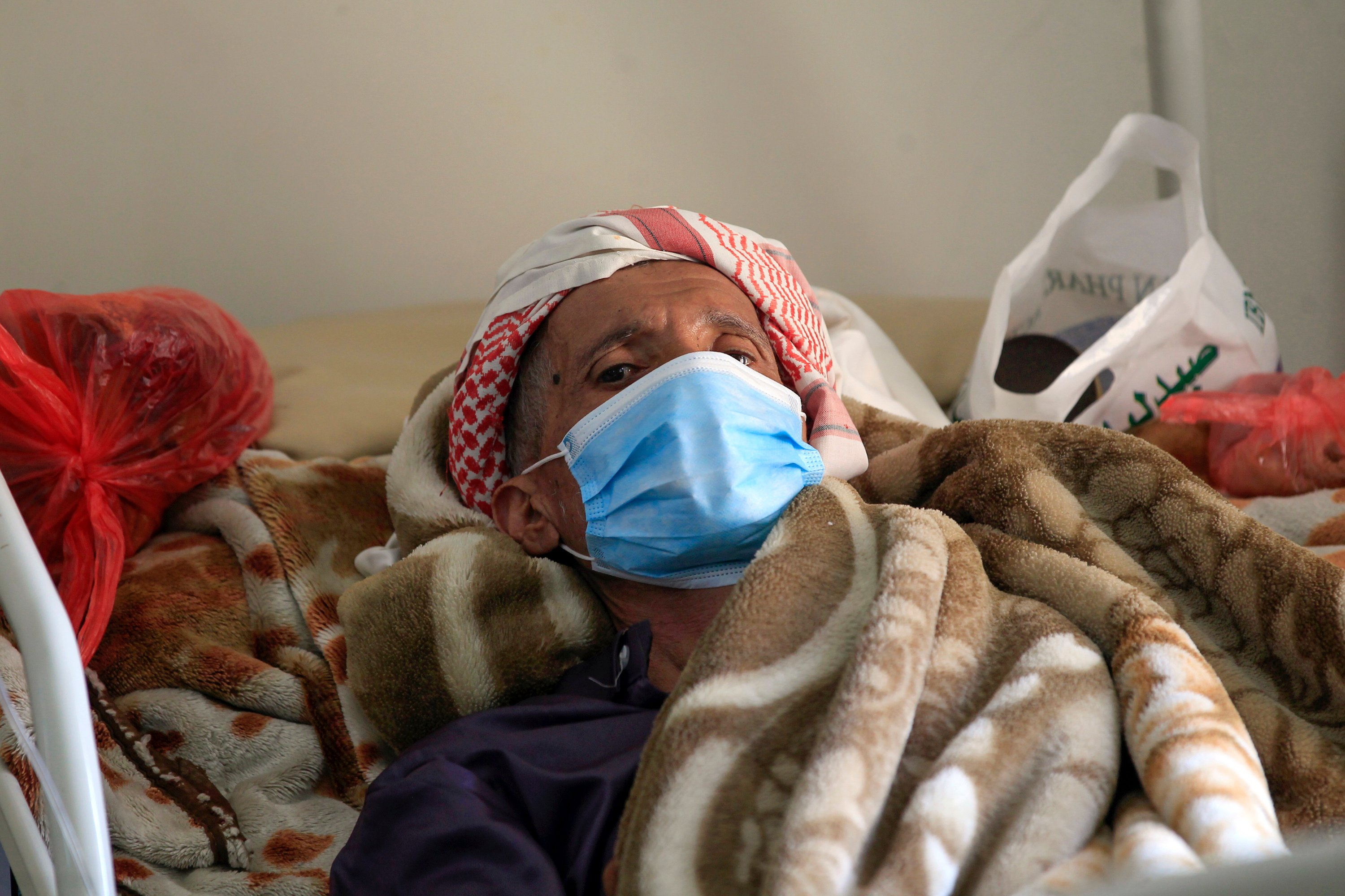 A Yemeni man suffering from cancer lies on a bed as he receives medical treatment at the National Oncology Centre in the capital Sanaa (AFP)