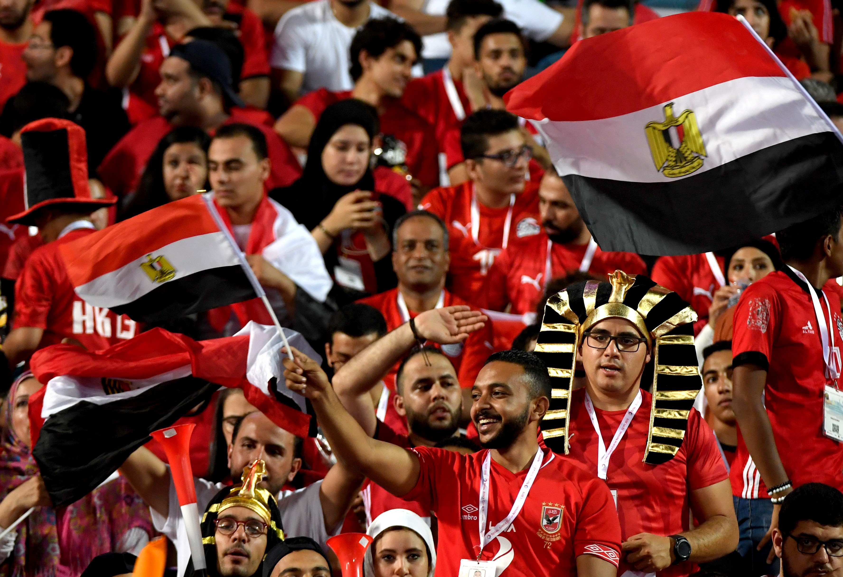 Egypt's fans cheer for their team prior to the 2019 Africa Cup of Nations (CAN) football match between Egypt and DR Congo at the Cairo International Stadium on 26 June (AFP)