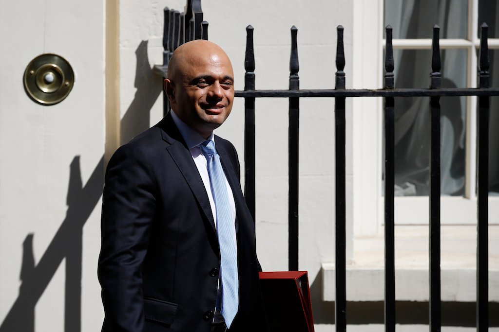 Britain's Chancellor of the Exchequer Sajid Javid leaves 11 Downing street on his way to the Houses of Parliament in London (AFP)