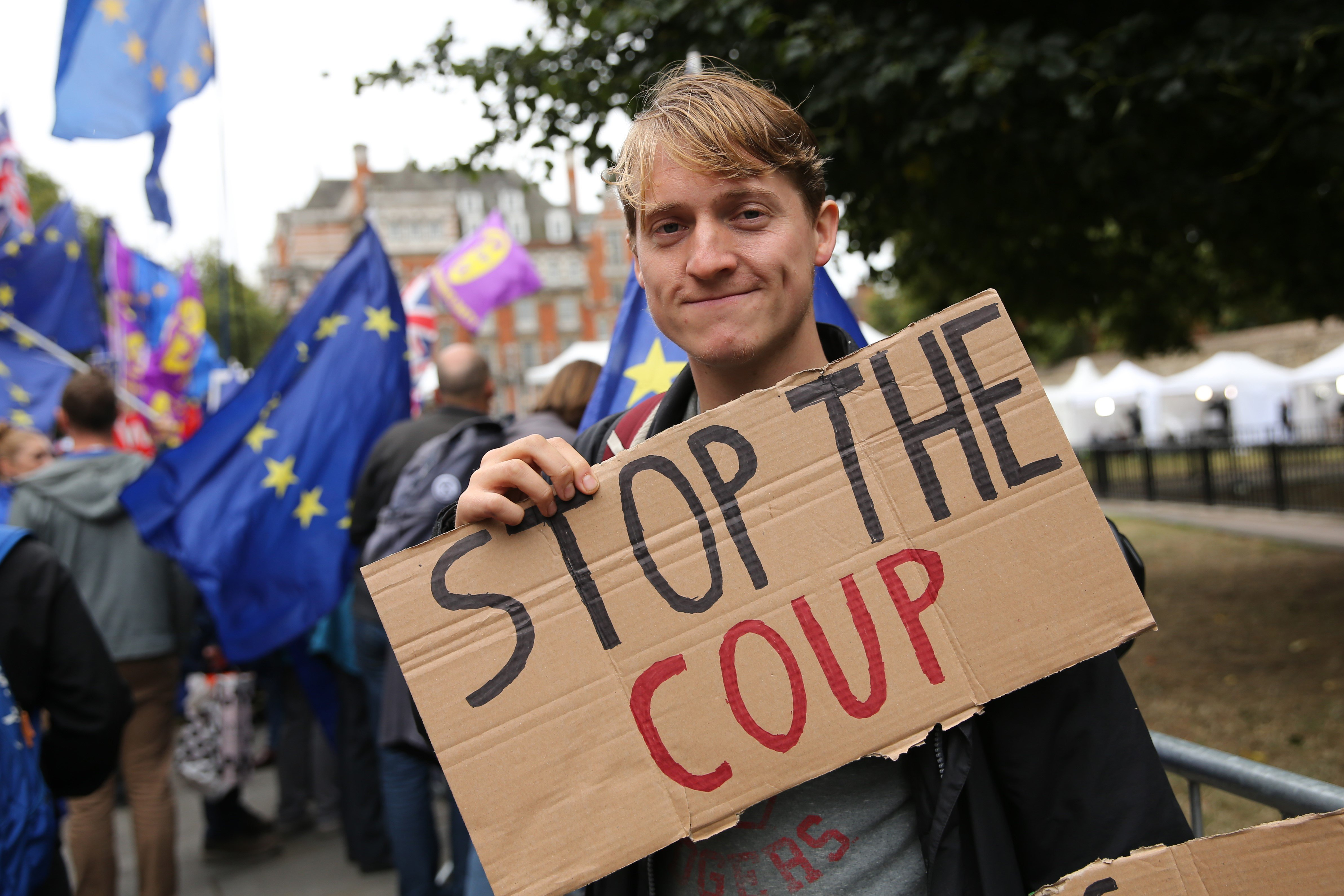 Anti-Brexit protesters stand protest outside the Houses of Parliament in London on September 9, 2019