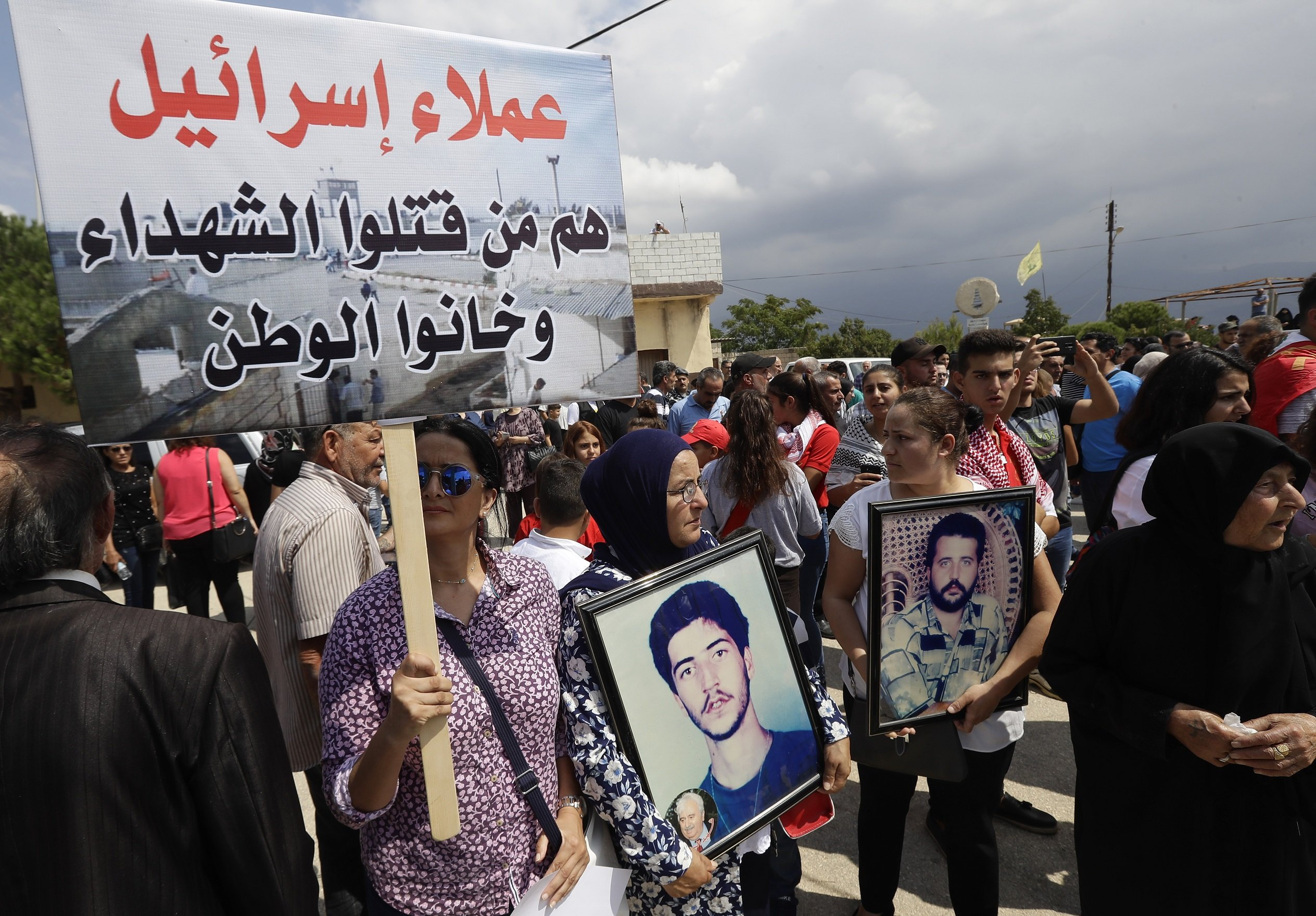 People protest in front of the former Khiam camp on the border with Israel to demand the trial of former commander of the pro-Israel South Lebanon Army Amer al-Fakhouri, 15 September 2019. (AFP)