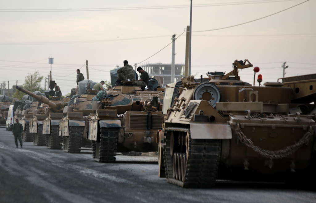 Tanks are pictured lined up as Turkish soldiers and Pro-Turkish Syrian fighters deploy near the Turkish village of Akcakale along the border with Syria (AFP)