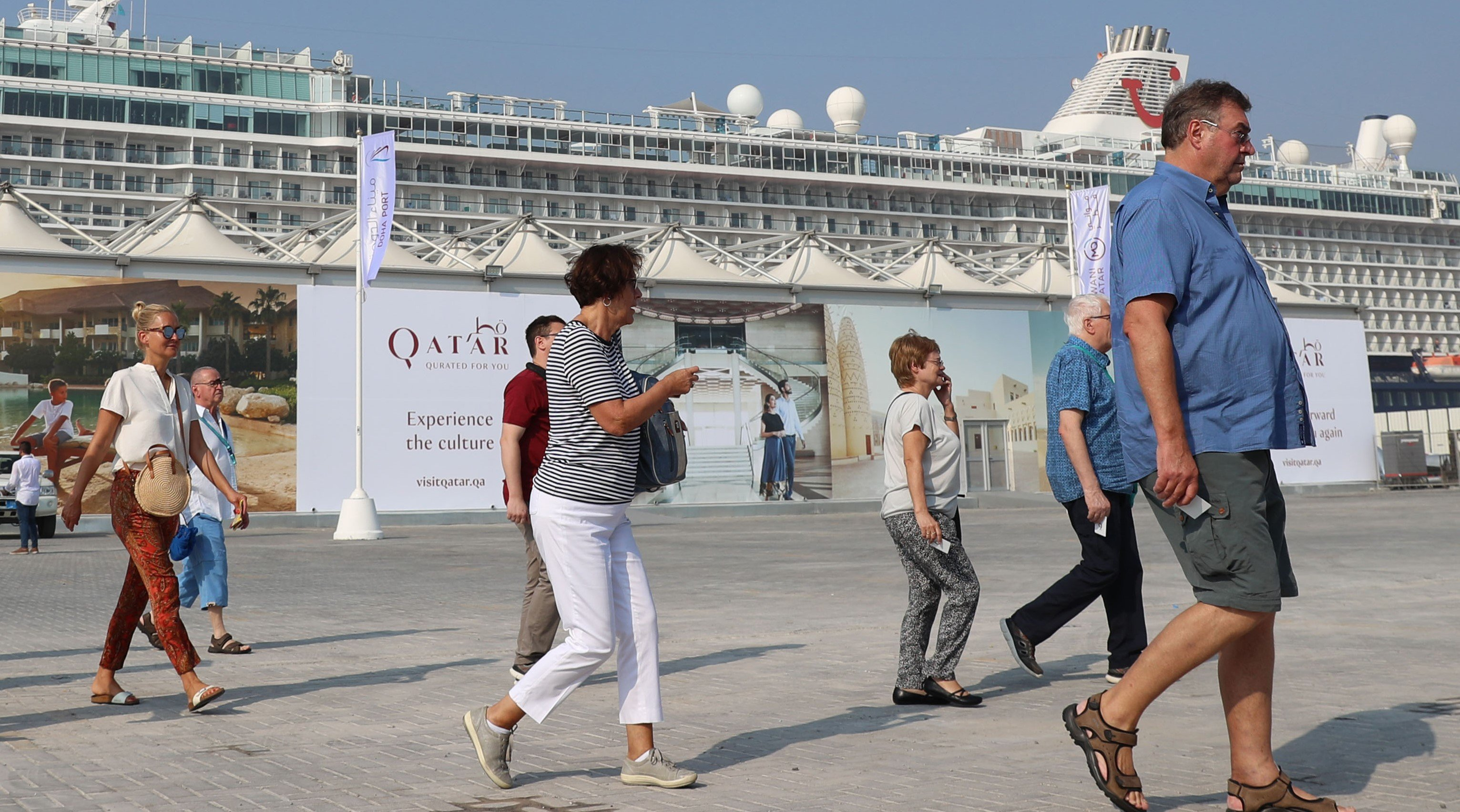 Tourists disembark at Doha Port as a new cruise season kicks off in Doha on 22 October (AFP)