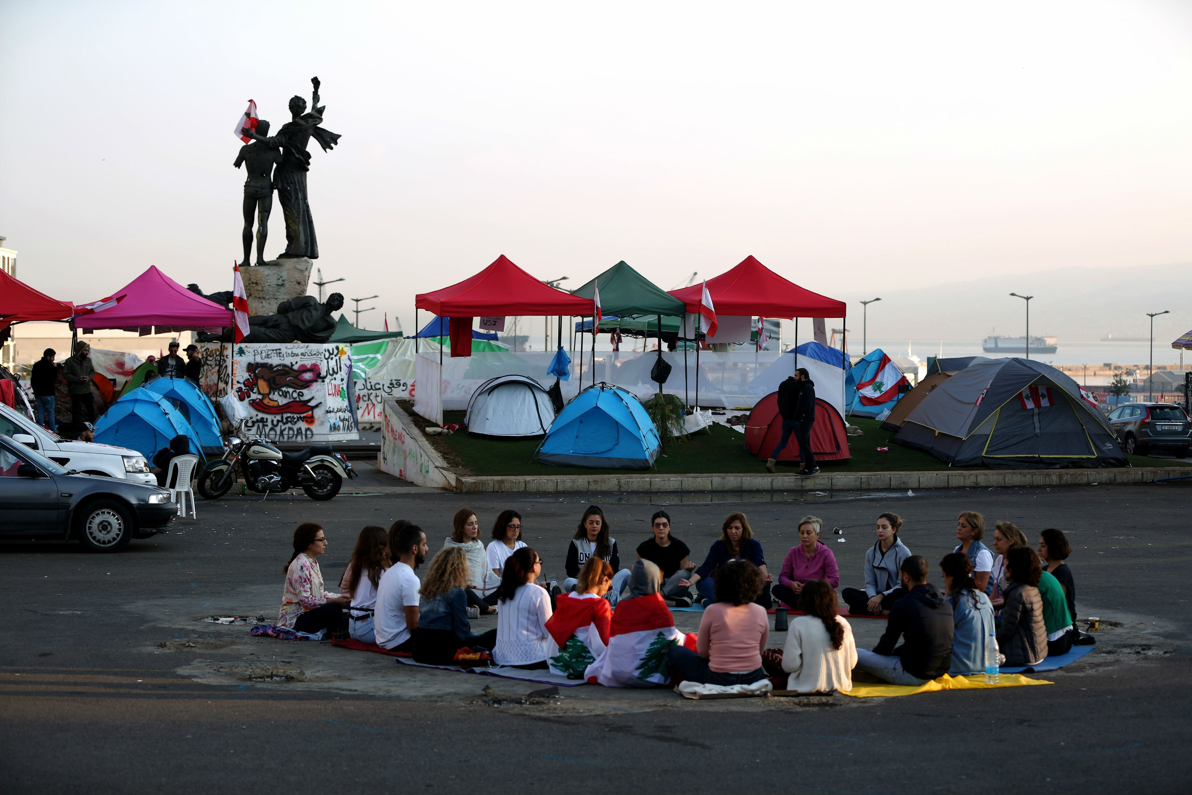 Lebanese protesters practice meditation in Beirut's Martyrs Square (AFP)