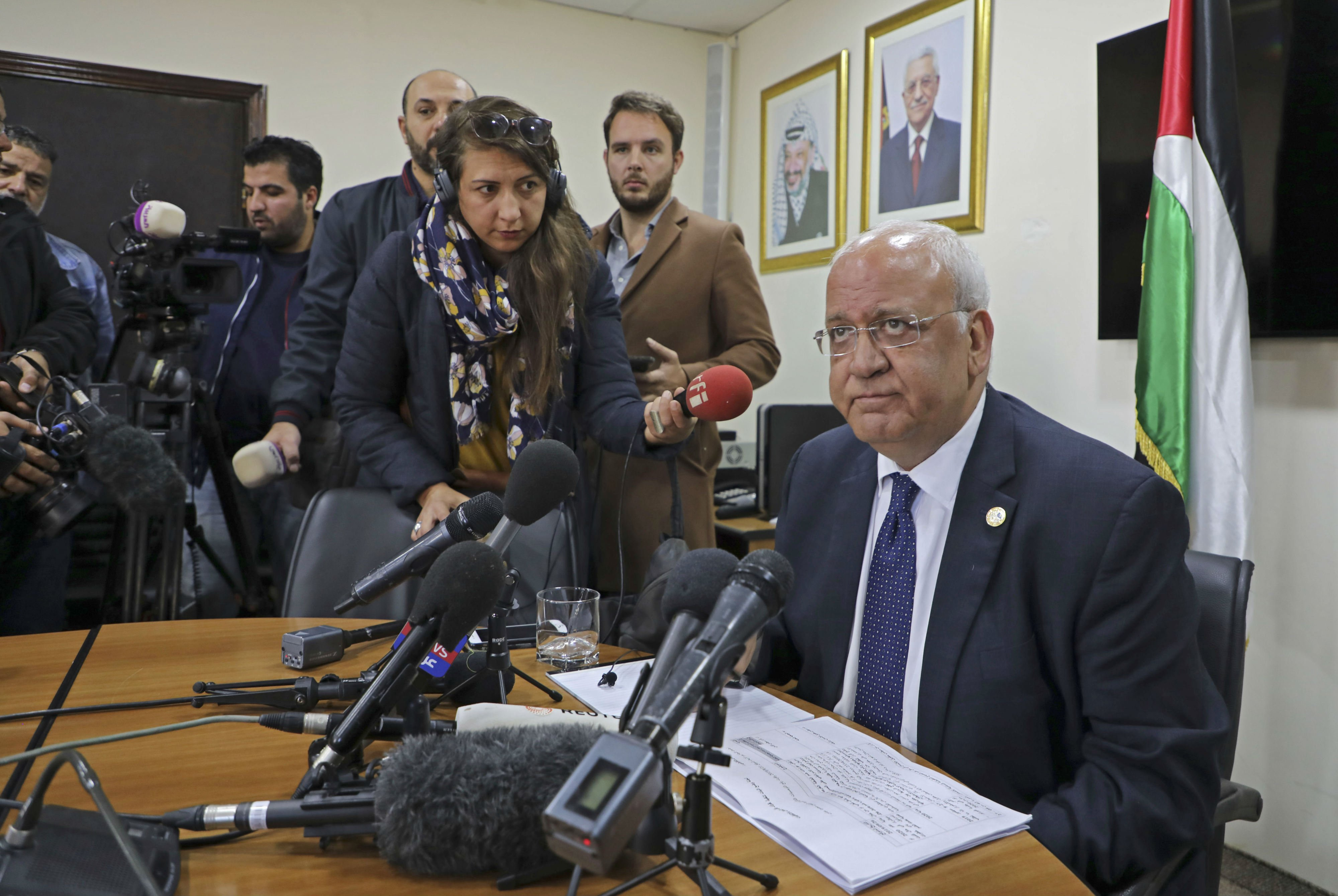 Saeb Erekat (R), Secretary General of the Palestine Liberation Organization (PLO) and chief Palestinian negotiator, speaks during a press conference in the Palestinian West Bank city of Ramallah (AFP)