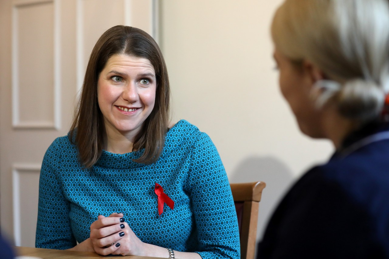 Britain's opposition Liberal Democrats leader Jo Swinson (L) reacts during a general election campaign visit to Bridge House Care Centre in Wallington, south of London (AFP)