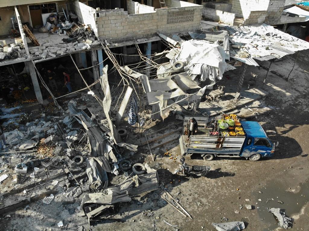Aerial view shows market in Maarat al Numan devastated from the air strikes (AFP)