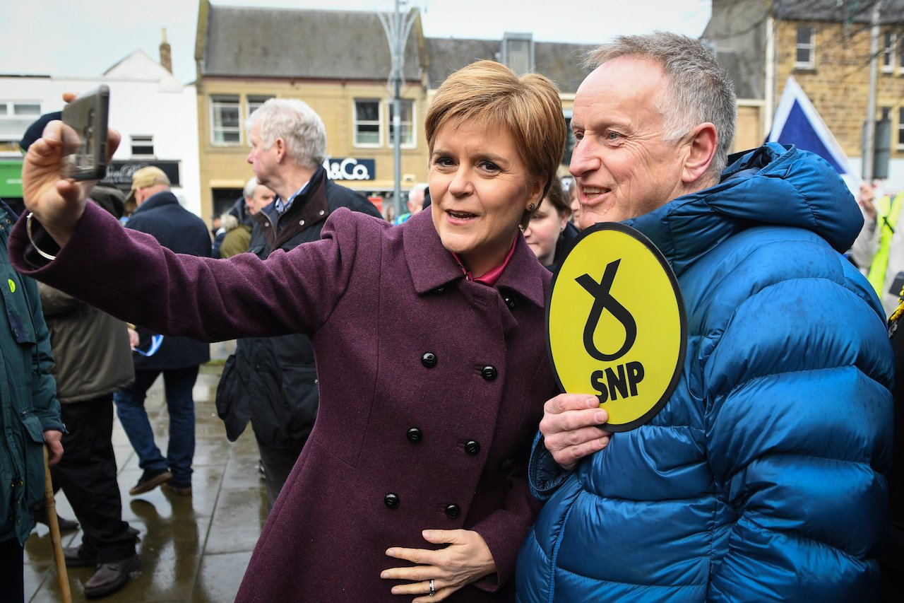Scottish National Party (SNP) leader Nicola Sturgeon greets supporters in Dalkeith while on the campaign trail (AFP)