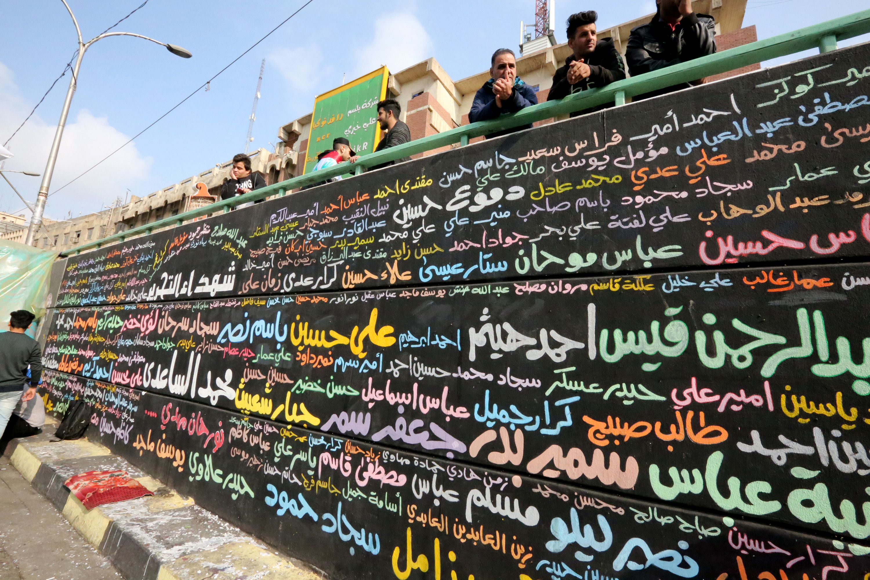 A memorial mural bearing names of demonstrators killed during ongoing anti-government protests is seen in Tahrir square in the capital Baghdad on 8 December (AFP)