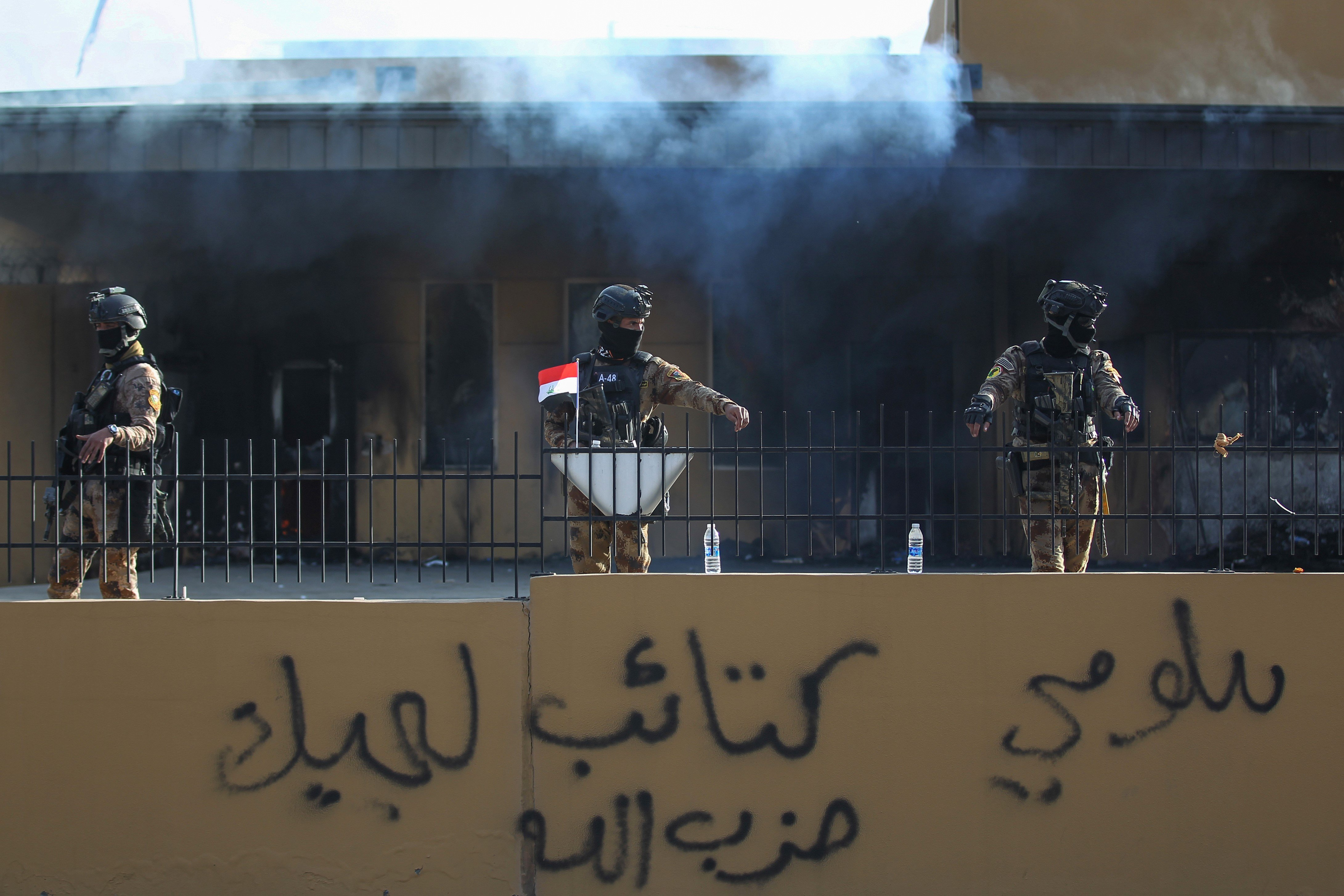Iraqi security forces are deployed in front of the US embassy in the capital Baghdad, on 1 January (AFP)