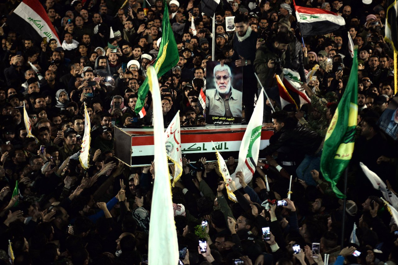 Mourners carry the coffin of slain Iraqi paramilitary chief Abu Mahdi al-Muhandis, toward the Imam Ali Shrine, in the shrine city of Najaf in central Iraq during a funeral procession (AFP)