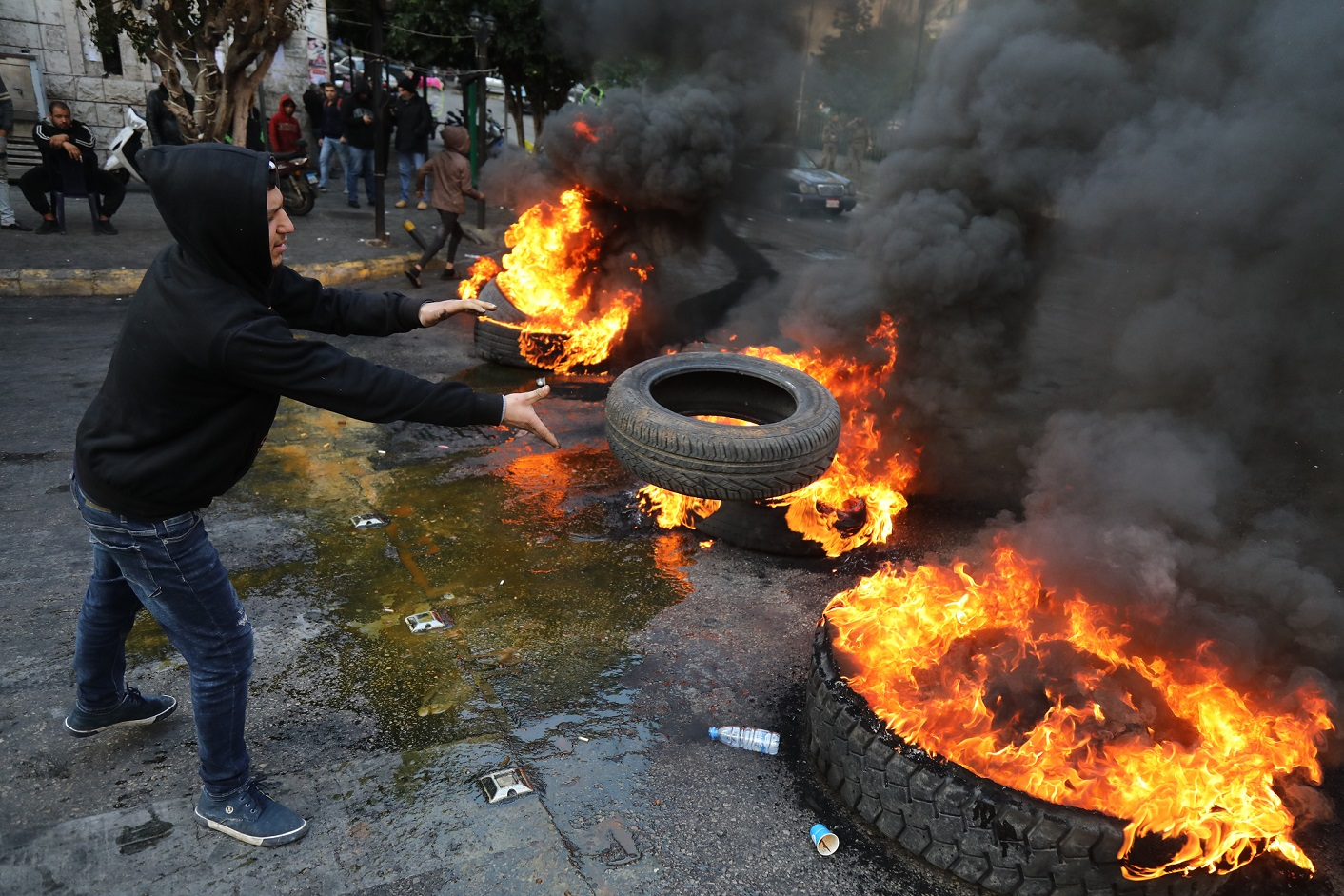 Protesters in Beirut burn tyres on 22 January (AFP)