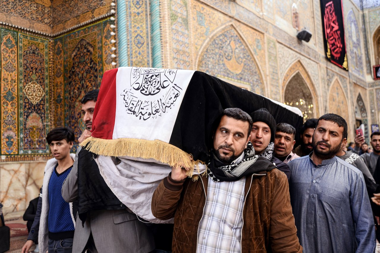 Mourners carry the coffin of a protester who was killed at an anti-government sit-in in Nasiriyah in Dhi Qar province, during his funeral in the central Iraqi holy shrine city of Najaf (AFP)