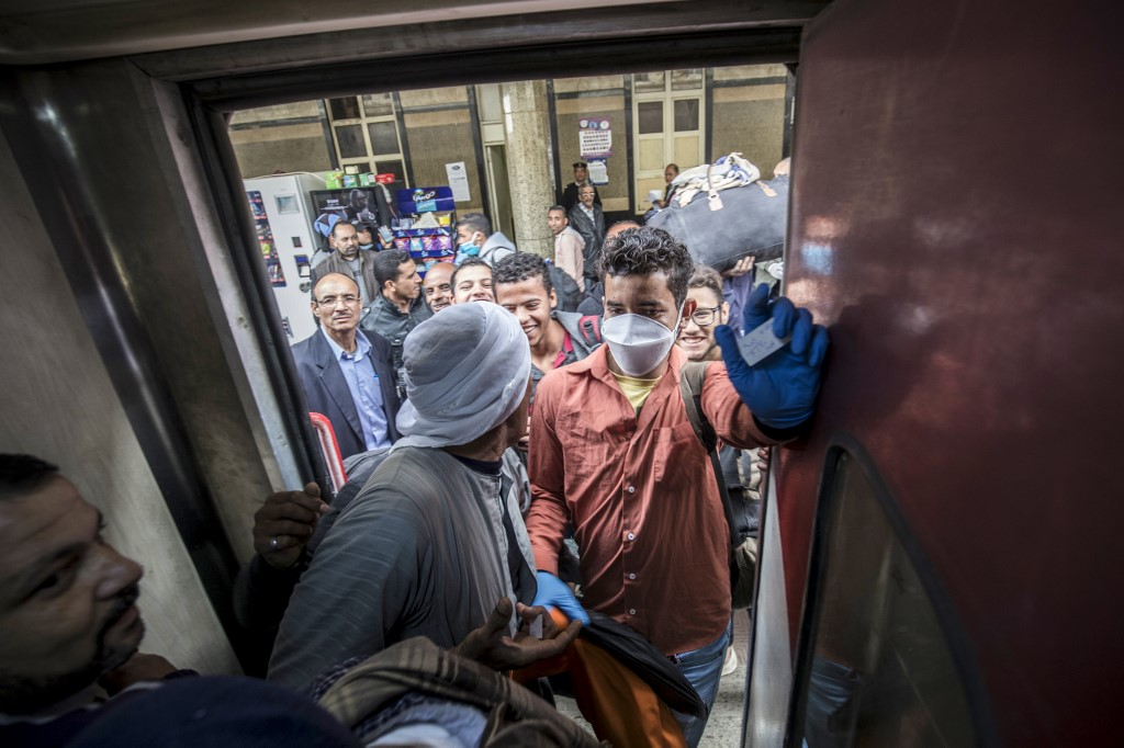 Passengers board a train at Cairo's Ramses railway station earlier this month (AFP)