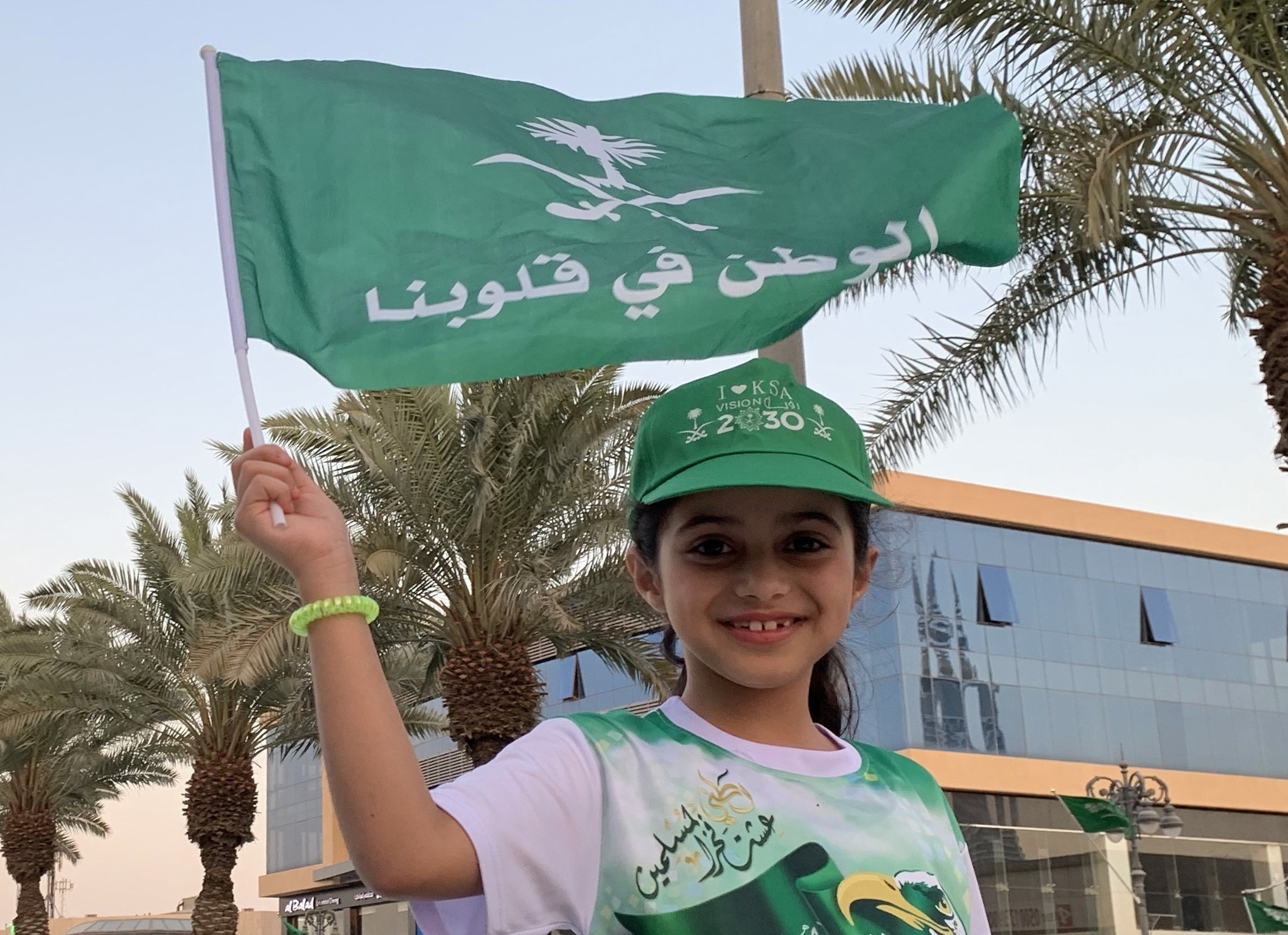A girl waves a flag during celebrations in Riyadh marking Saudi Arabi's National Day on 23 September (AFP)
