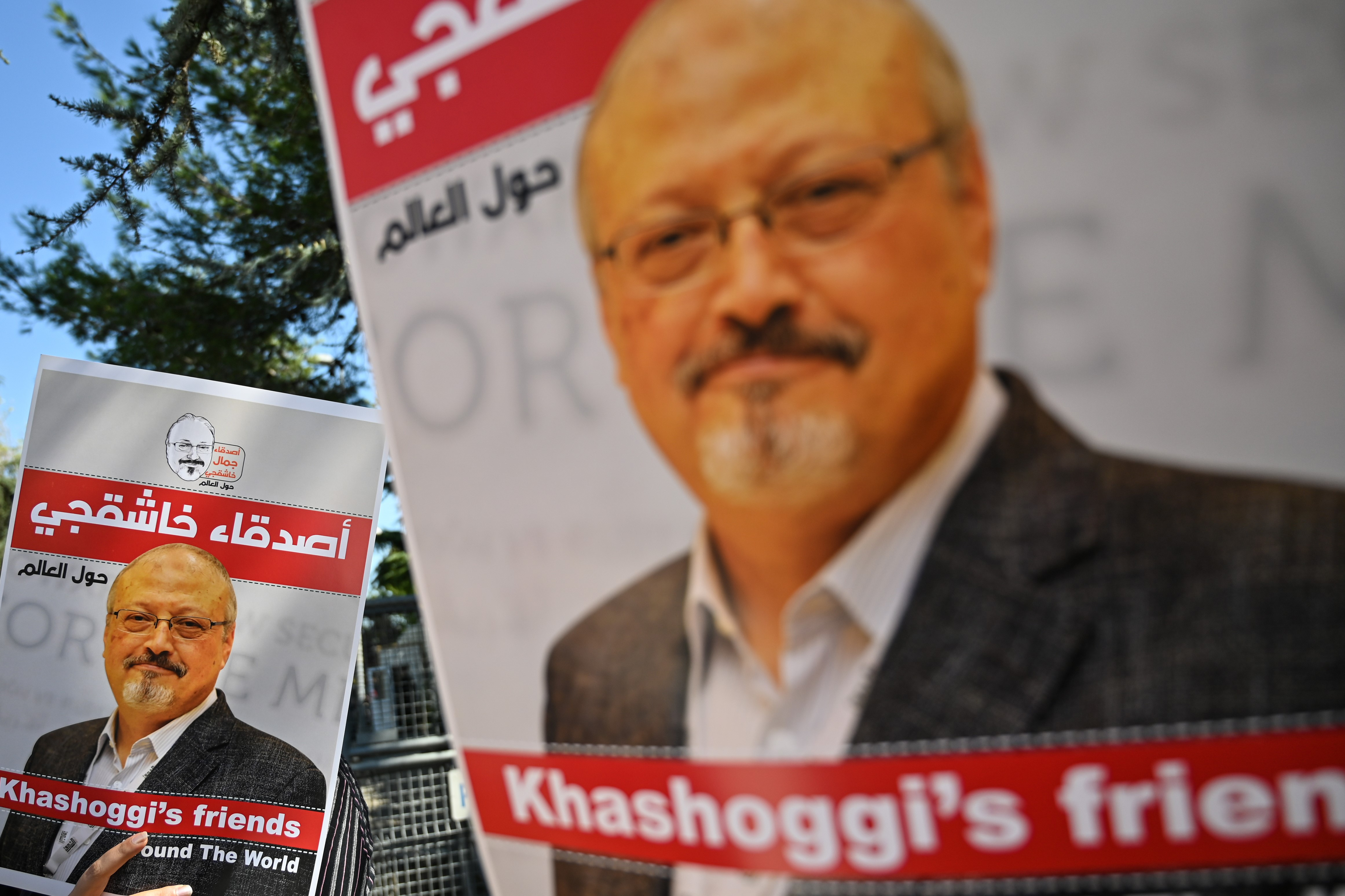 Friends of murdered Saudi journalist Jamal Khashoggi hold posters bearing his picture as they attend an event marking the second-year anniversary of his assassination in front of Saudi Arabia Istanbul Consulate, on October 2, 2020.