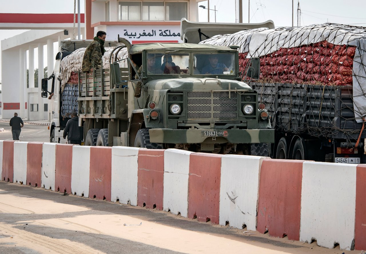 A Moroccan army vehicles drives in Guerguerat, located in the Western Sahara, on 26 November 2020 (AFP)