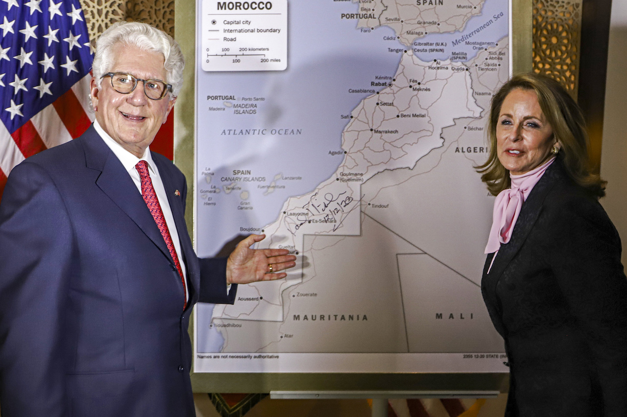David T. Fischer, US Ambassador to the Kingdom of Morocco, and his wife Jennifer stand before a US State Department-authorised map of Morocco recognising Western Sahara as part of Morocco (AFP)