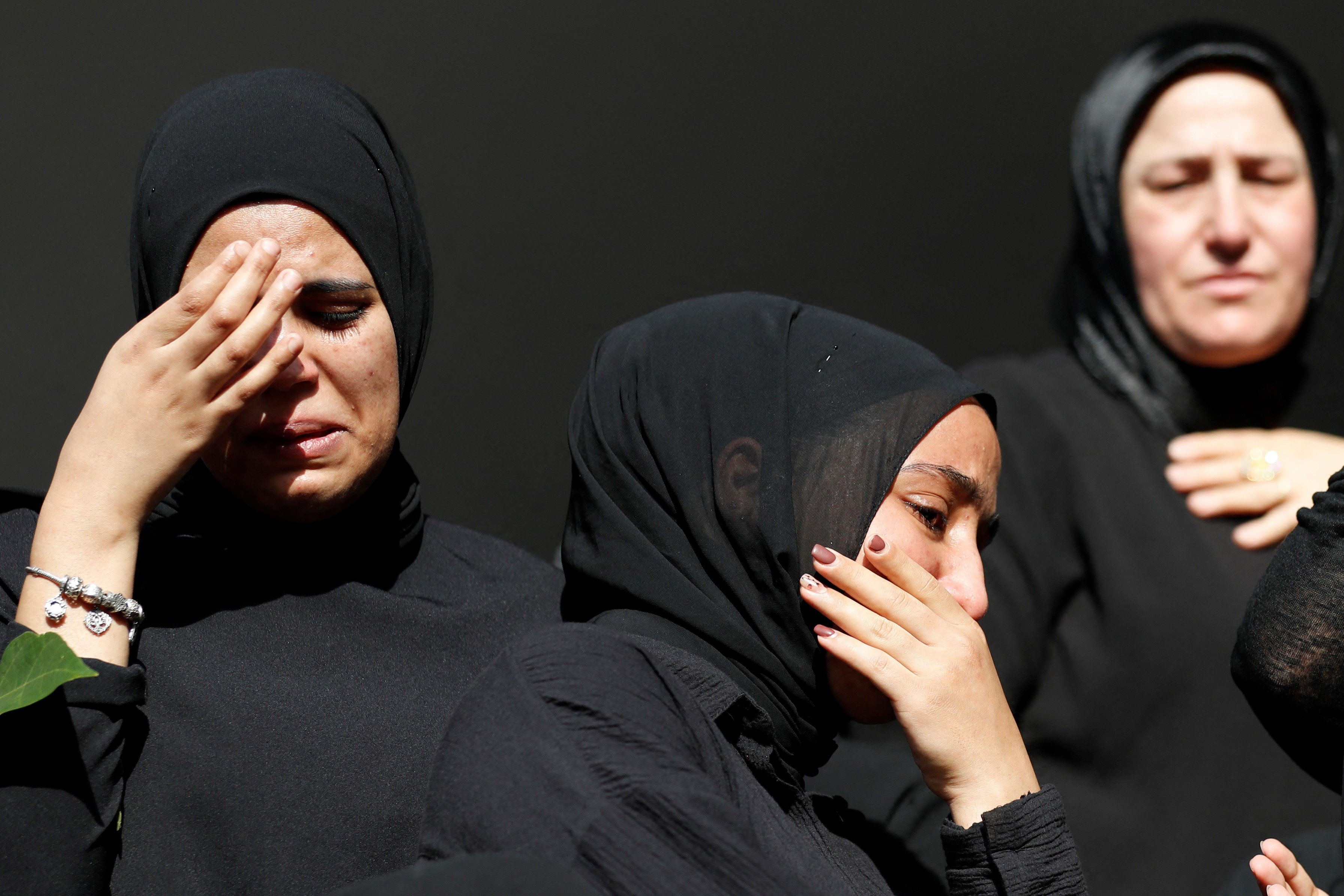 Women mourn the death of Mohammad Kiwan, a 17-year-old Palestinian who succumbed to his wounds after being shot during confrontations with Israeli troops last week, during his funeral in the mostly Arab city of Umm al-Fahm in northern Israel, on May 20, 2021.