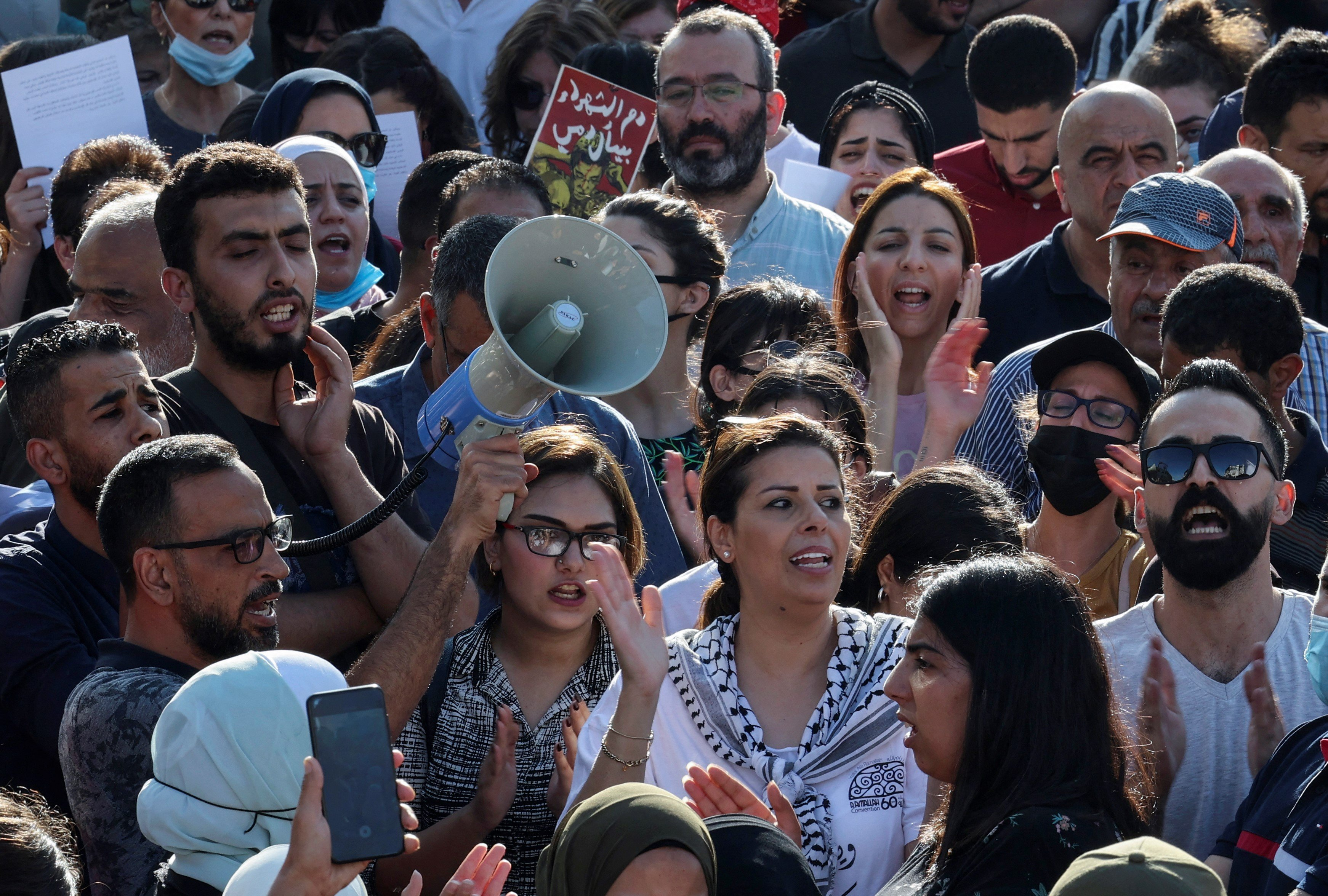 Palestinian demonstrators chant during a rally in Ramallah city in the occupied West Bank on July 11, 2021