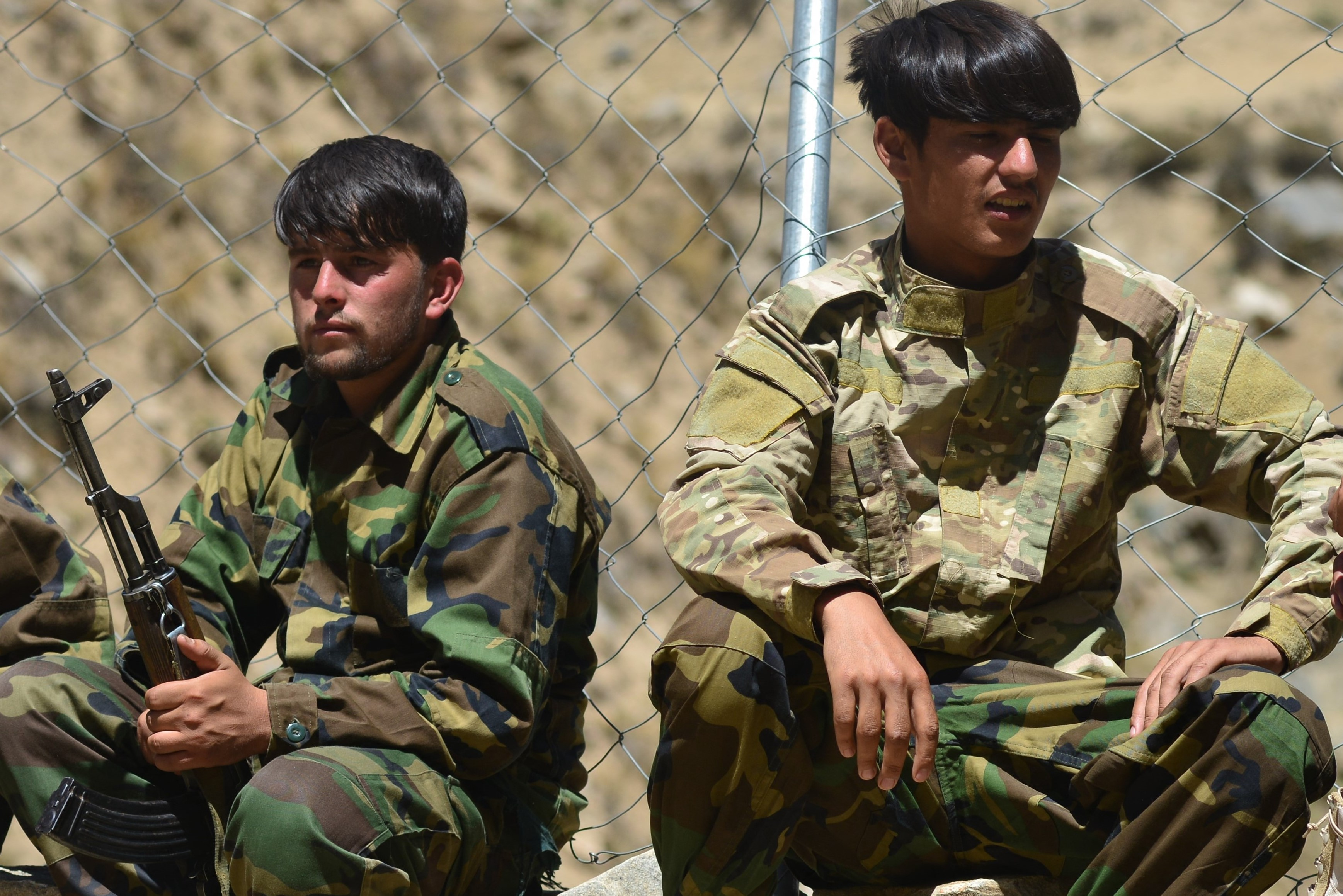 Afghan resistance movement and anti-Taliban uprising forces rest during military training at the Abdullah Khil area of Dara district in Panjshir province on August 24, 2021