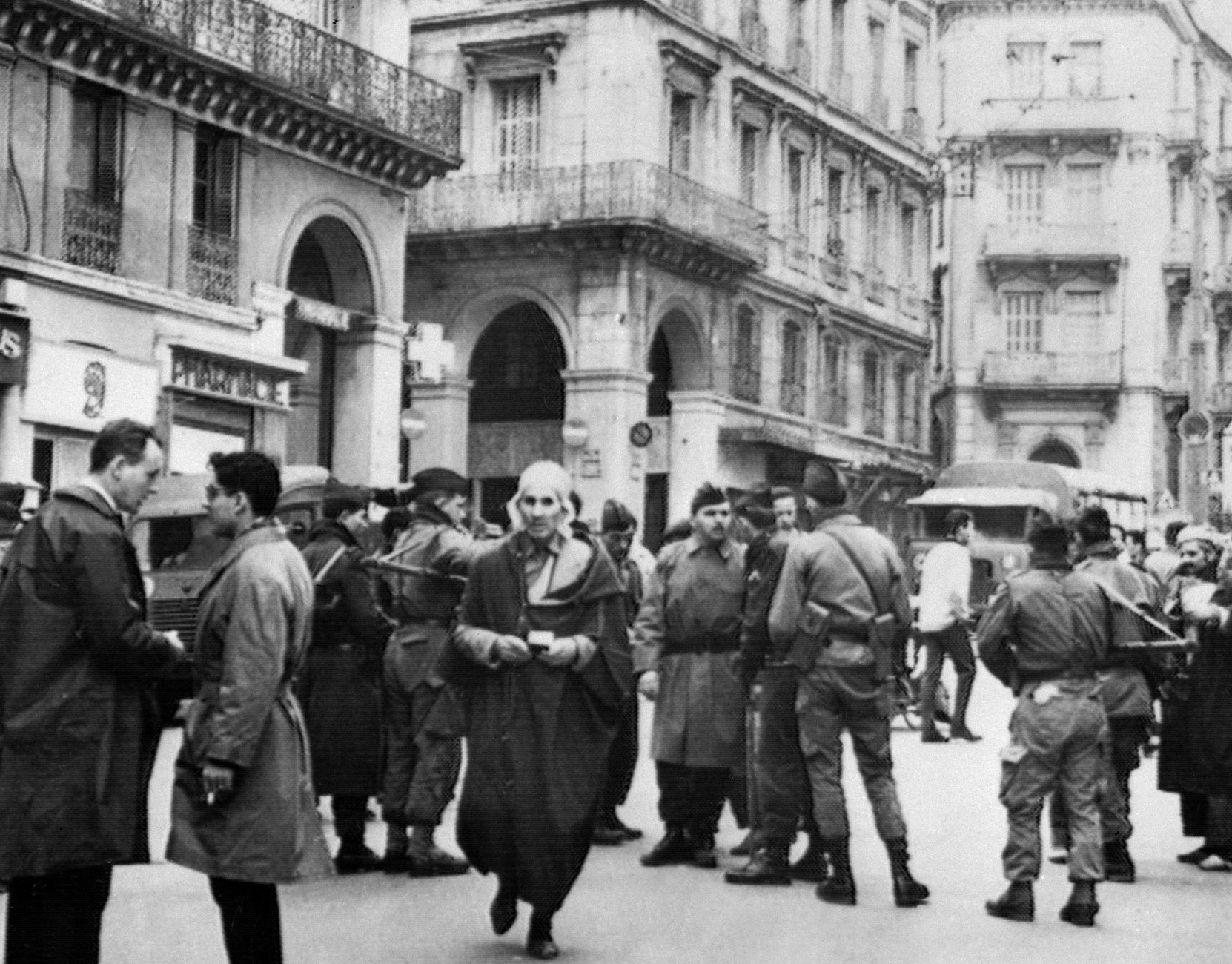 French Soldiers check the identity of Muslims at a check point on 12 December, 1960 in Algeria a few days before the UN statement acknowledging the right to the self-determination for Algerians.