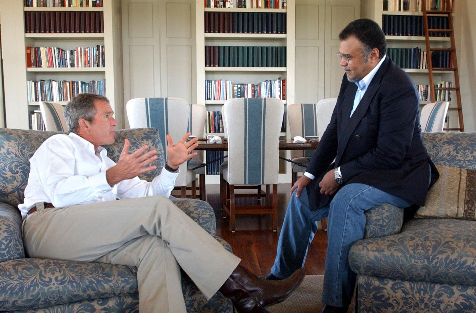 US President George W. Bush (L) meets with Saudi Arabian Ambassador to the US Prince Bandar bin Sultan at the Bush Ranch 27 August 2002 in Crawford, Texas.