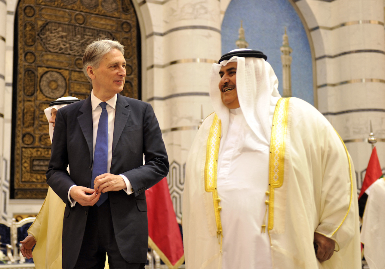 Britain's then Foreign Secretary Philip Hammond (L) speaks with Bahrain's Foreign Minister Khalid bin Ahmed al-Khalifa in Jeddah (AFP) in 2016
