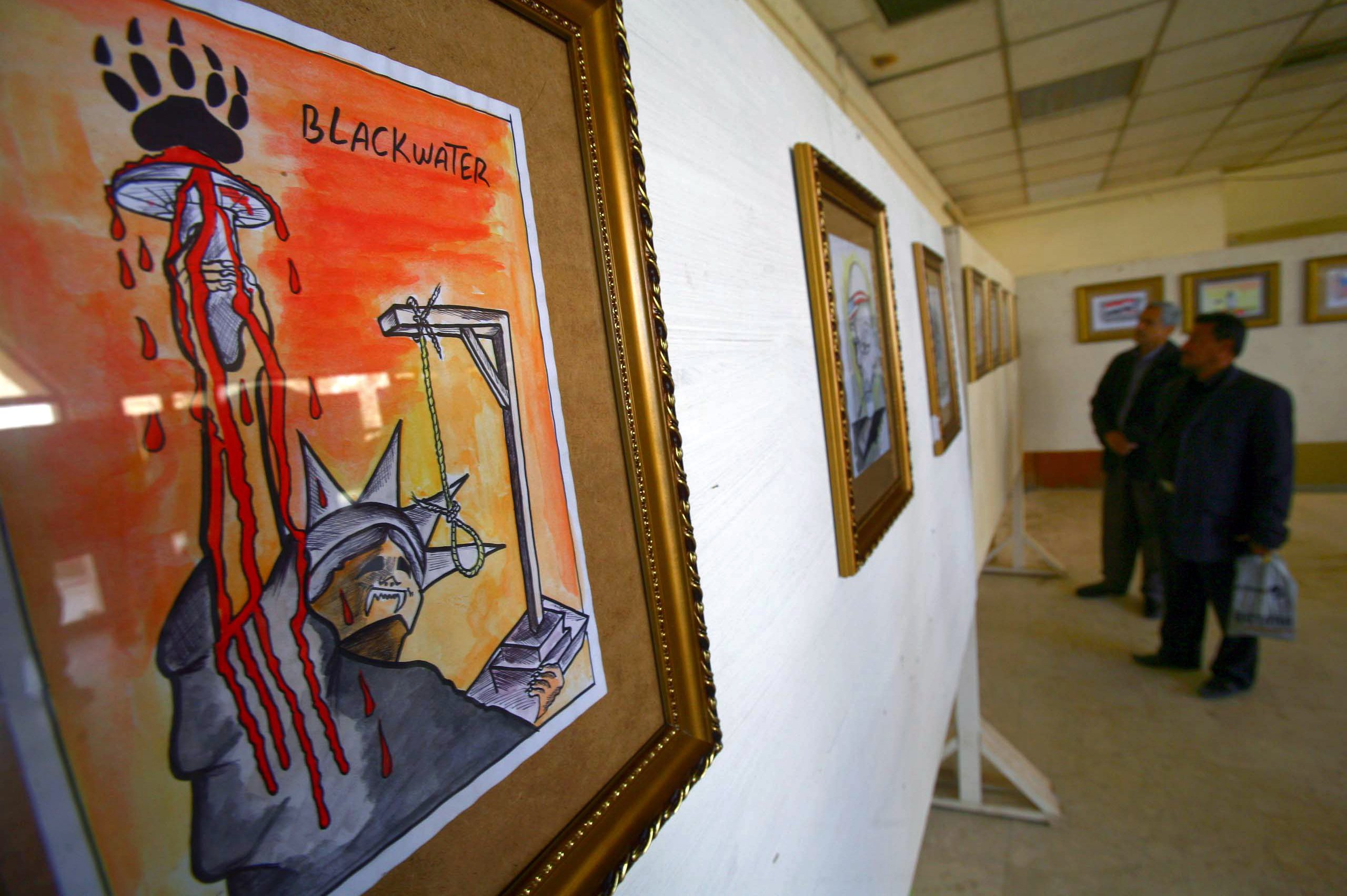A cartoon against US security firm Blackwater, which was barred from Iraq over the deadly 2007 shooting, is displayed at an exhibition in Karbala, central Iraq in 2011 (AFP)