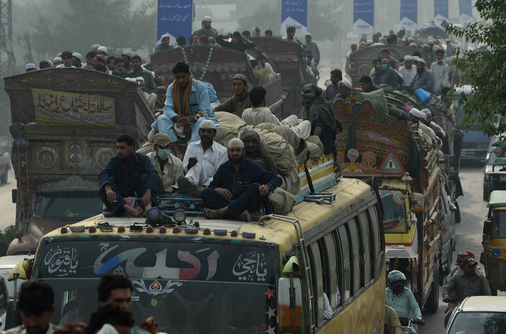 Pakistani passengers sit atop buses as they make their way home from the three-day annual Tablighi Ijtema religious gathering in Raiwind on the outskirts of Lahore on November 6, 2016.