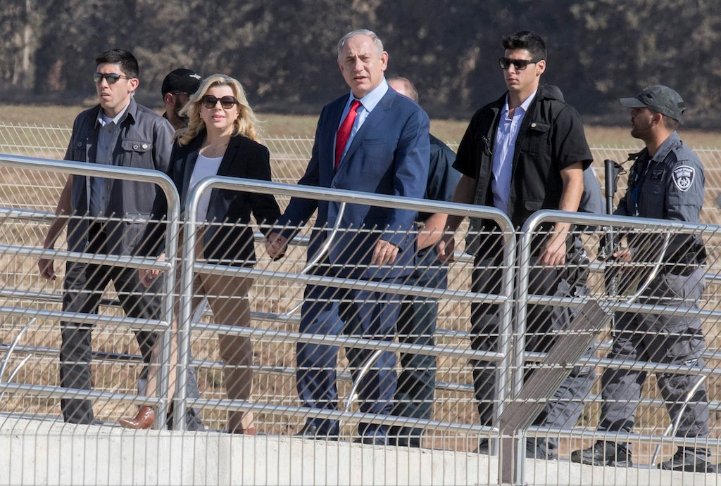 Israeli Prime Minister Benjamin Netanyahu (C) and his wife Sara (2-L) arrive for an inauguration event for the Haifa-Beit Shean railway line, on 8 November 2016 in the northen city of Afula (AFP)