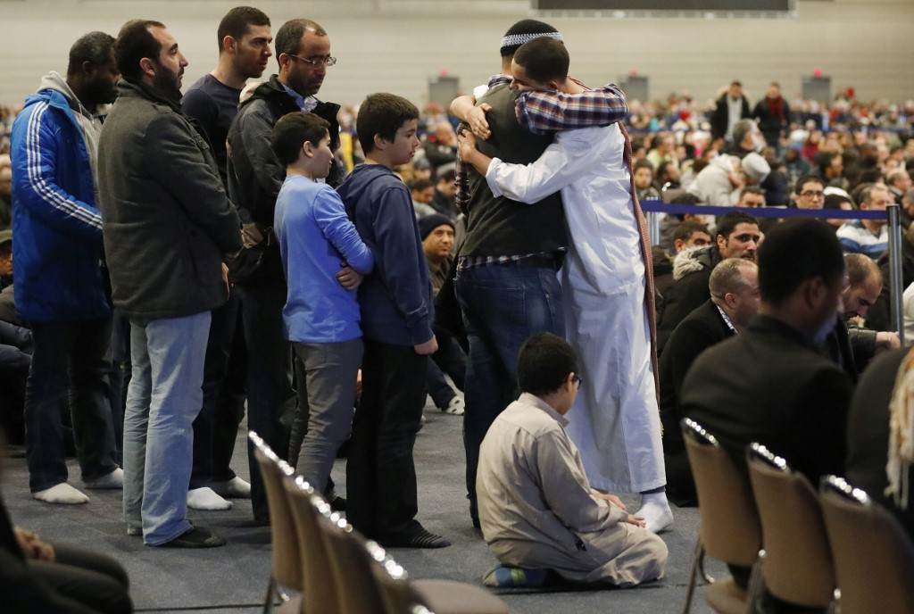 Funeral services are held for victims of the 2017 Quebec mosque shooting (AFP)