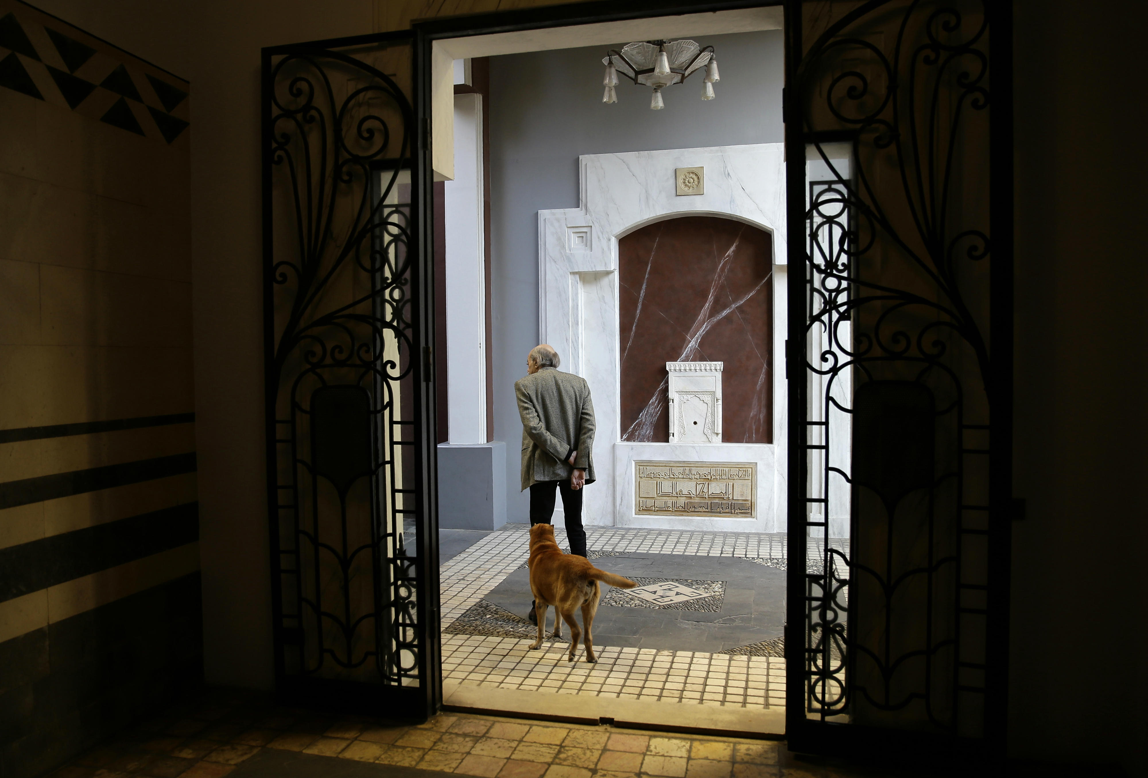 Lebanese Druze leader Walid Joumblatt walks with his Shar-Pei dog Oscar at his house in Beirut's Clemenceau street (AFP)